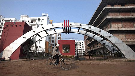 A man cycles past residential apartments in Patna.