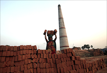 A labourer works at a brick factory at Hajipur industrial park on the outskirts of Patna.