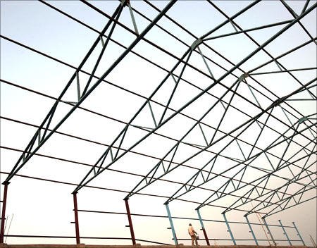 A labourer works at a factory under construction at Hajipur industrial park on the outskirts of the eastern Indian city of Patna.