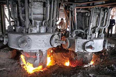 An employee works inside a steel factory on the outskirts of Jammu.