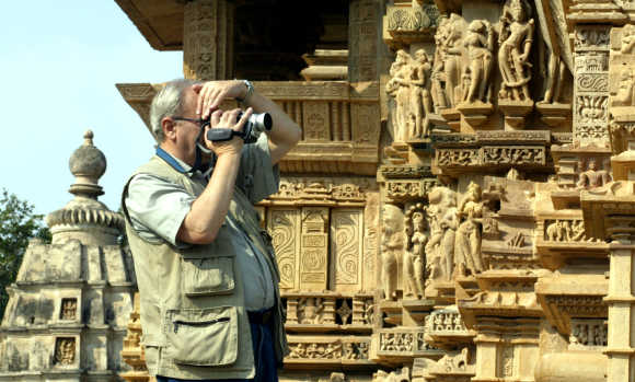 A tourist takes pictures of Khajuraho in Madhya Pradesh.