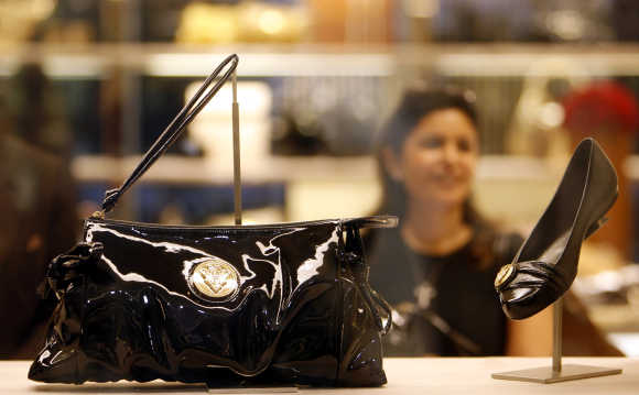 A woman looks at the products on display at a Gucci showroom in Mumbai.