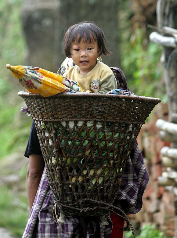 A woman carries her daughter in Khonoma village, on the outskirts of Kohima, capital of Nagaland.