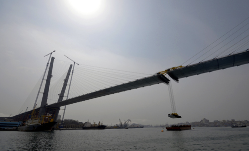 The final section is installed to complete the bridge across the Golden Horn bay in Vladivostok.