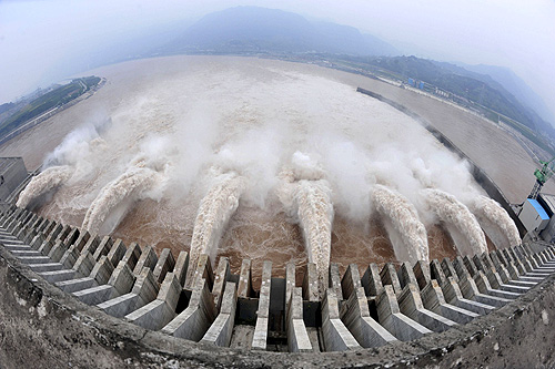 The Three Gorges Dam Project discharges flood water to lower the water level in the reservoir in Yichang, Hubei province.