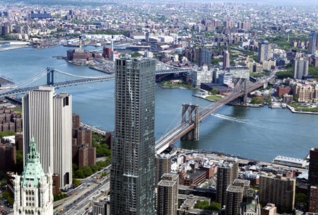 The Brooklyn Bridge (R) and Manhattan Bridge is seen from the 90th story of One World Trade Center in New York.