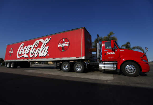 A Coca-Cola truck fills up with diesel fuel at a gas station in Carlsbad, California.