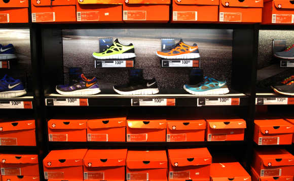 Nike running shoes are shown on display and for sale at a store in Encinitas, California.