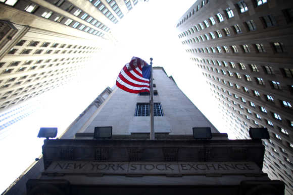 Flag flies at exterior of New York Stock Exchange.