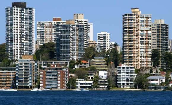 Luxury houses and apartments with multi-million dollar price tags tower over Sydney Harbour.