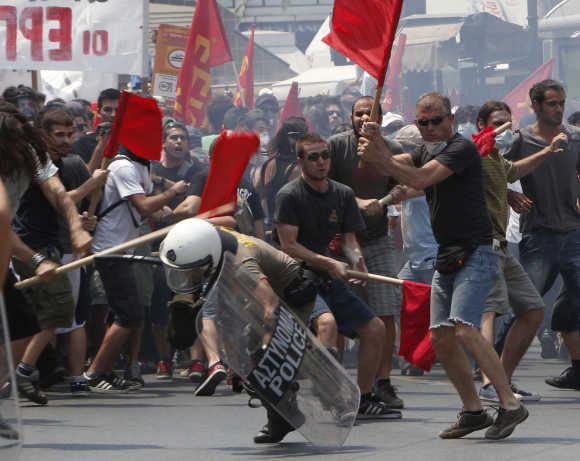 Protesters beat a riot policeman during a rally against government austerity measures in Athens.