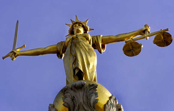 A statue of the Roman Goddess Justicia stands on top of the old Bailey in Cental London.
