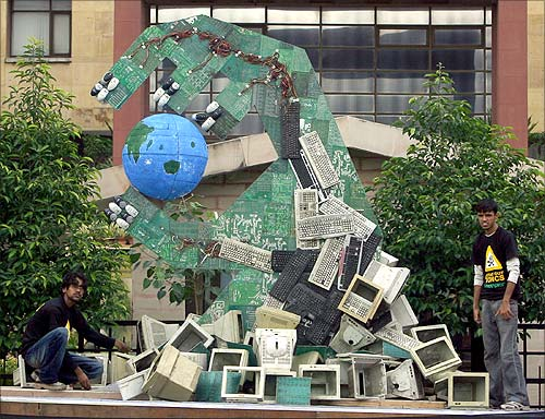 Greenpeace activists set up an art installation made of dismantled computers to send a message on hazardous electronic waste.