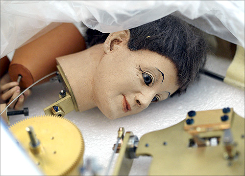 The head of an automaton is pictured in a box in the workshop of Swiss artisan Francois Junod in Sainte-Croix.