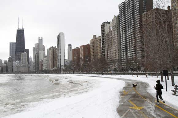 A man runs along Lake Michigan in Chicago.
