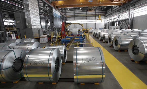 Steel coils wait to be shrink wrapped and shipped to customers at the Severstal steel mill in Dearborn, Michigan.