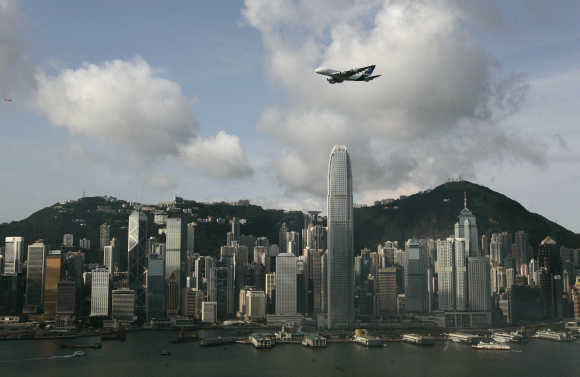 An Airbus A380 flies over Hong Kong's Victoria Harbour in Hong Kong.