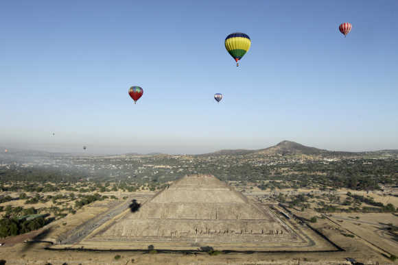 Hot air balloons float above the Pyramid of the Sun of Teotihuacan outside Mexico City.