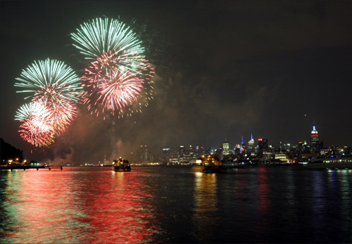 Fireworks explode over the Hudson River and the skyline of New York during the Macy's Independence Day celebration as seen from Hoboken, New Jersey.
