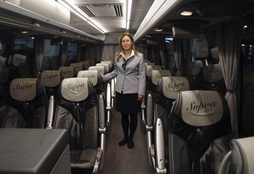 Tania Leon, a 29 year-old stewardess, poses for a picture inside a bus in Santiago de Compostela, Spain.