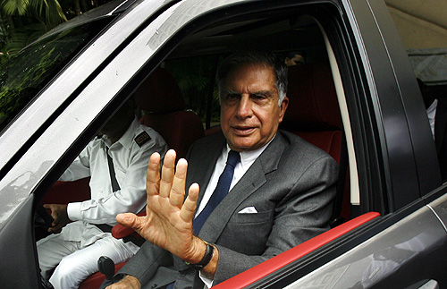 Tata Motors Chairman Ratan Tata waves as he leaves after addressing a news conference.