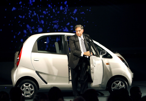 Ratan Tata, steps out from Nano car during its launch at the 9th Auto Expo in New Delhi.