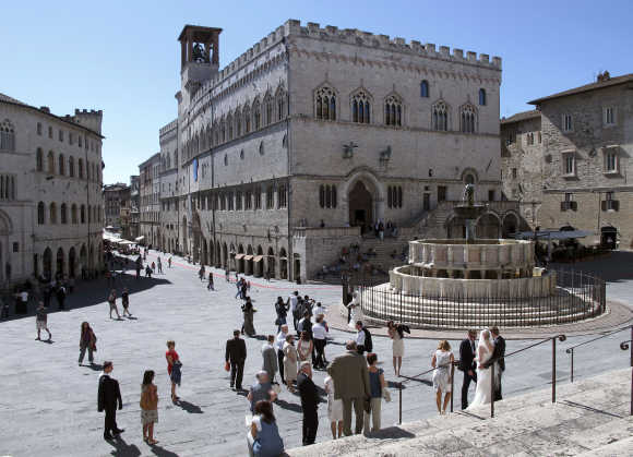 A view of Priori Palace and Maggiore fountain in downtown Perugia, Italy.