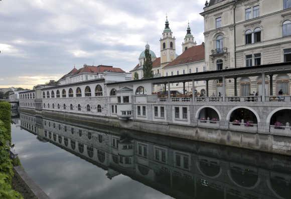 River Ljubljanica float near closed market in old part of Ljubljana, Slovenia.