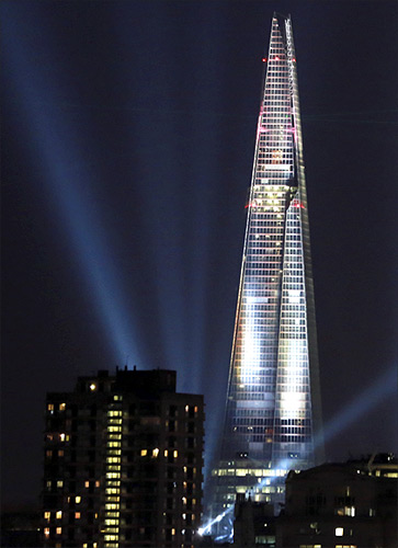 A laser and searchlight show marks the completion of the exterior of the Shard building in central London.