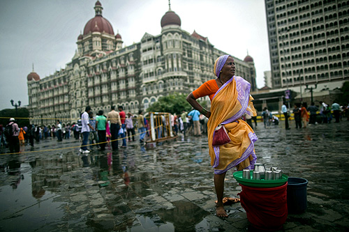 A woman sells drinking water near the Taj Mahal hotel in Mumbai.