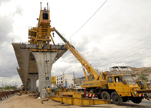 Labourers work at a flyover undergoing construction in Hyderabad.