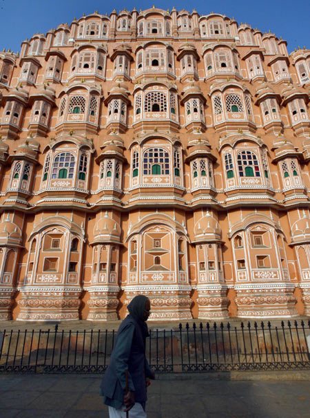 A man walks in front of Hawa Mahal also known as 'Palace of Winds' in Jaipur.