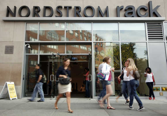 People walk past the Nordstrom Rack store in New York's Union Square.