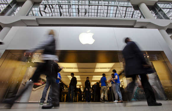 People walk by the Apple Store in the Eaton Centre shopping mall in Toronto.