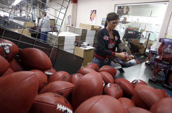 A woman packages footballs in Ada, Ohio.