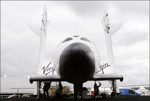 orkers prepare Virgin Galactic's SpaceShipTwo ahead of the Farnborough Airshow 2012.