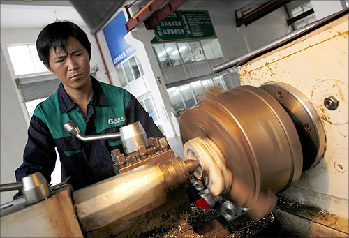 A labourer works at a valve factory in Wenzhou, Zhejiang Province.