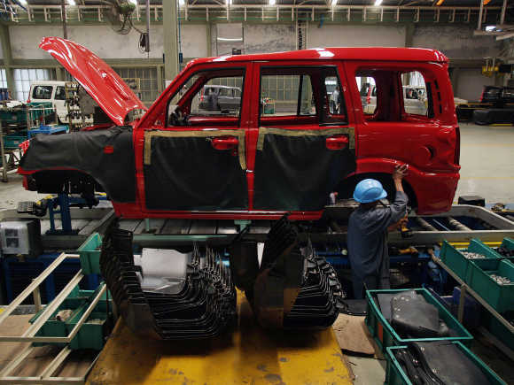 A mechanic works at a Mahindra & Mahindra car factory in Nashik.