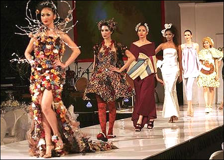 Models present creations made from recycled plastic or organic materials during the Eco Chic Fashion show in Jakarta.