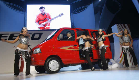Models prepare to get in Maruti Suzuki's Eeco car in New Delhi.