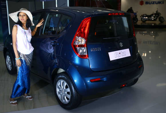 A model poses with Ritz car during its launch in New Delhi.