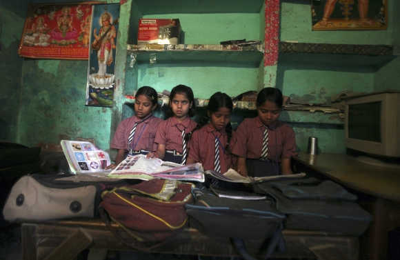 School girls inside their classroom at a primary school at Bhangel village in Uttar Pradesh.