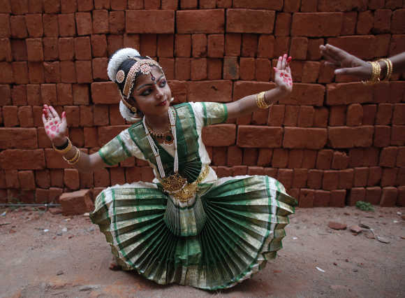 A girl practices Bharatnatyam before a performance in Trivandrum.