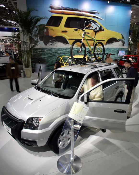Visitors look at a Ford EcoSport utility vehicle in Sao Paulo, Brazil.