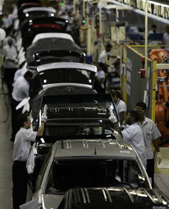 Workers at a plant in Camacari in Brazilian state of Bahia.