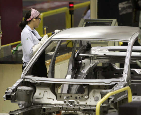 A worker inspects a Ford Ecosport vehicle in Brazilian state of Bahia.