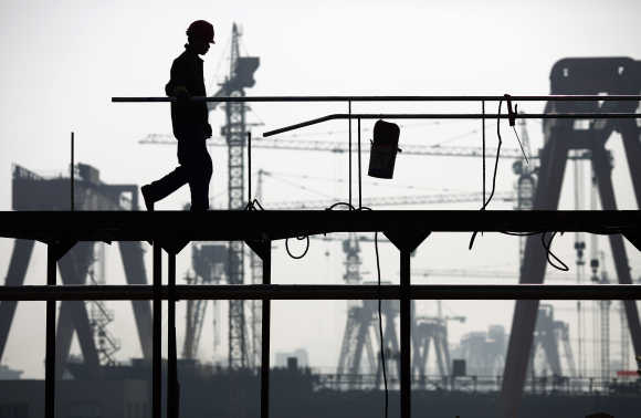 A labourer works at a shipyard in Yueqing City, Zhejiang Province, China.