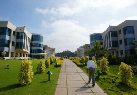 An employee walks at the Infosys campus in Electronics City in Bangalore.