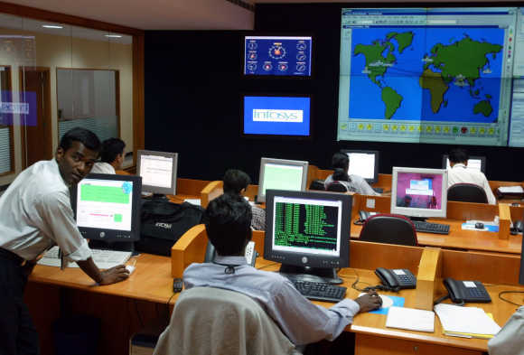 Engineers work in the control room at Infosys campus at Electronics City in Bangalore.
