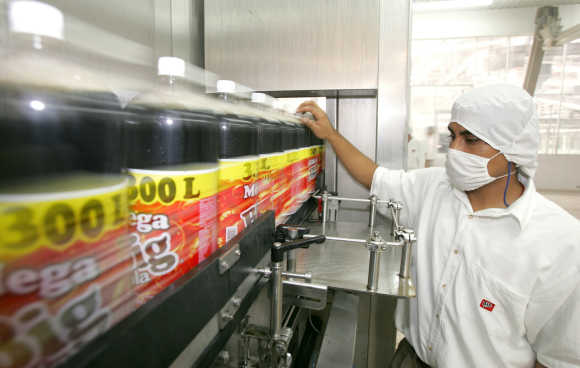 Mexican worker checks the quality of Big-Cola bottles at a plant in Huejotzingo, Mexico.